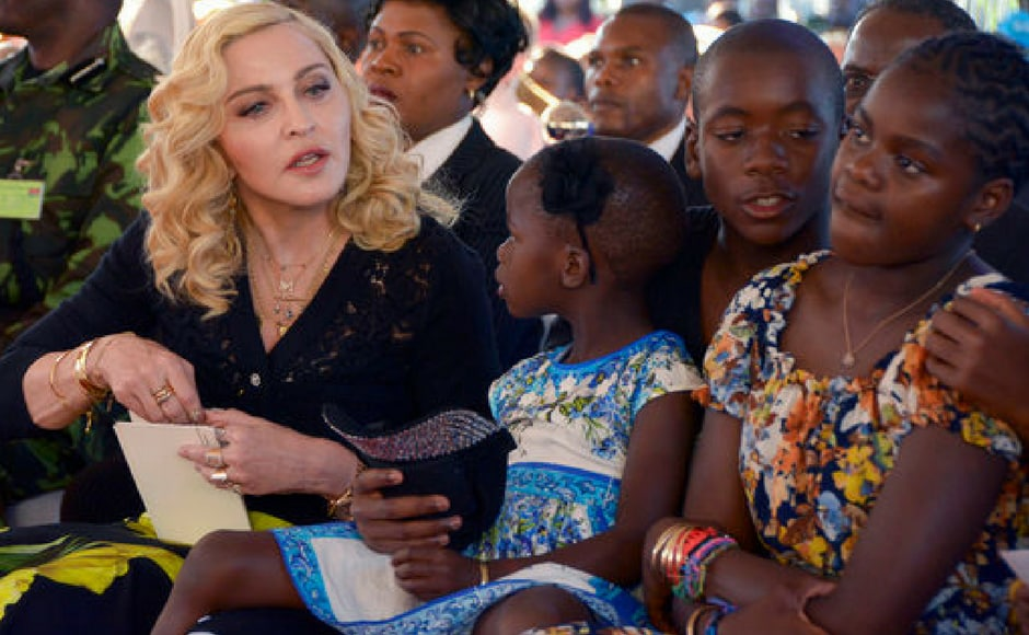 Madonna, left, sits with her adopted children Stella, David and Mercy, at the opening of The Mercy James Institute for Pediatric Surgery and Intensive Care, located at the Queen Elizabeth Central Hospital in the city of Blantyre, Malawi. (AP Photo)