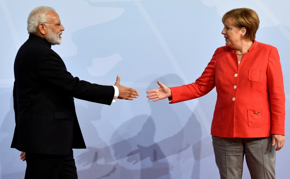 German Chancellor Angela Merkel welcomes Prime Minister Narendra Modi among other leaders of the Group of 20 global economic powers to a two-day summit in Hamburg. Reuters