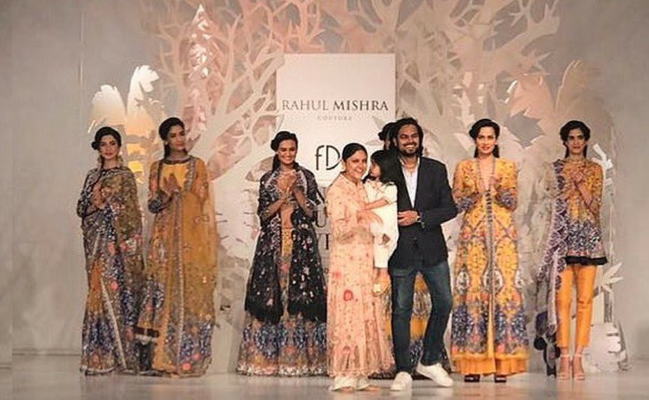 Rahul Mishra asked his family to wear his beautiful designs and walk the runway to close his  instead of getting a celebrity to be the showstopper at his fashion show. Image via FDCI/twitter.