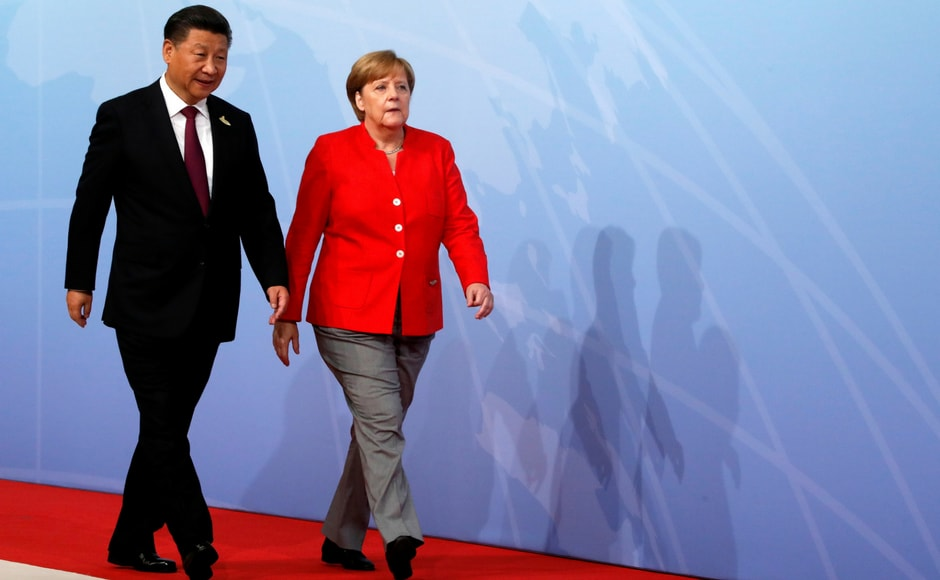 Chinese president Xi Jinping is welcomed by Angela Merkel on the first day of the G20 summit. The meeting at the city's trade fair centre opened on Friday with a discussion on fighting terrorism — one of the least contentious subjects on an agenda that also includes global trade and climate. Reuters