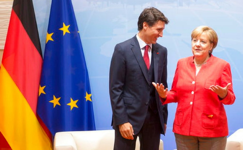 Prime Minister Justin Trudeau hears out Merkel during a bilateral meeting at the G20 summit. AP