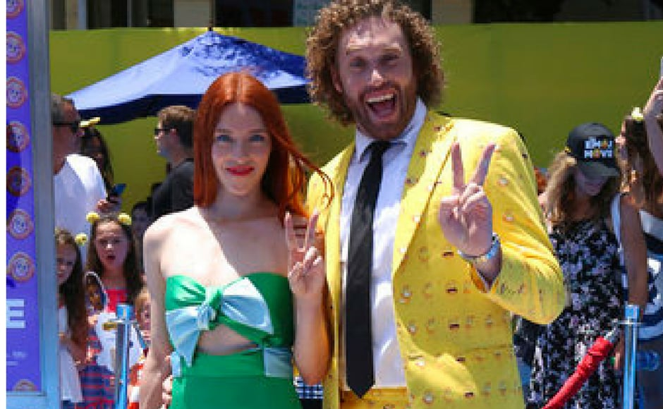 Kate Gorney and T.J. Miller arrive at the World Premiere of The Emoji Movi ein Los Angeles. Miller has lent his voice to the lead character of Gene, an outsider 'meh' emoji. (AP Photo)