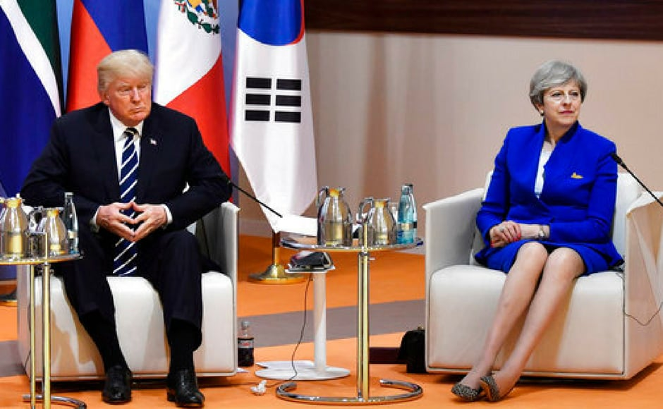 "US president Donald Trump and Britain's prime minister Theresa May at the start of the informal ""retreat meeting"" on the first day of the summit in Hamburg. AP"