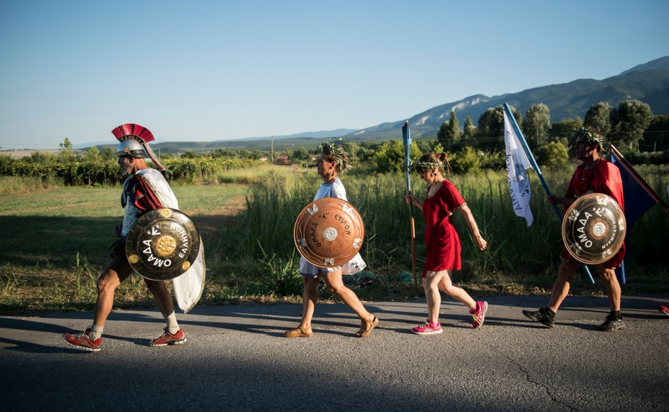The annual run from the archaeological site of Dion sees runners dress as ancient warriors, wearing costumes once on sale as novelty items to tourists and now held together with staples and duct tape. AP