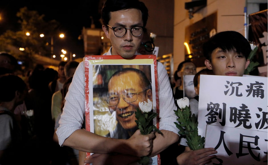Liu's face was emblazoned on countless signs during Hong Kong's annual pro-democracy rally and march on Saturday, underscoring how he had become a unifying figure among the Opposition in Hong Kong that has been criticised relentlessly by the territory's leaders. AP