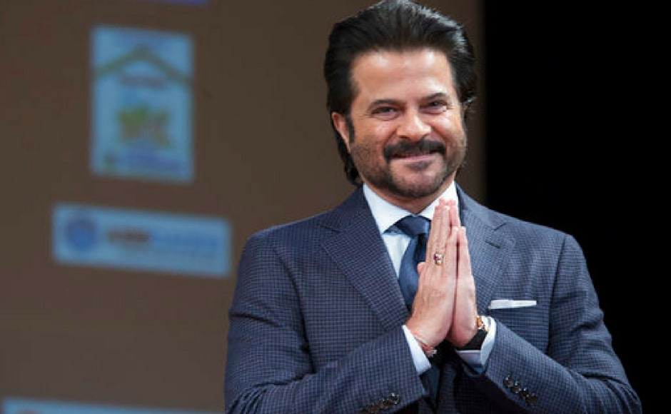 Actor Anil Kapoor reacts to audience applaud as he arrives on stage for a Bollywood Fireside Chat at the Asia Society in New York. (AP Photo)