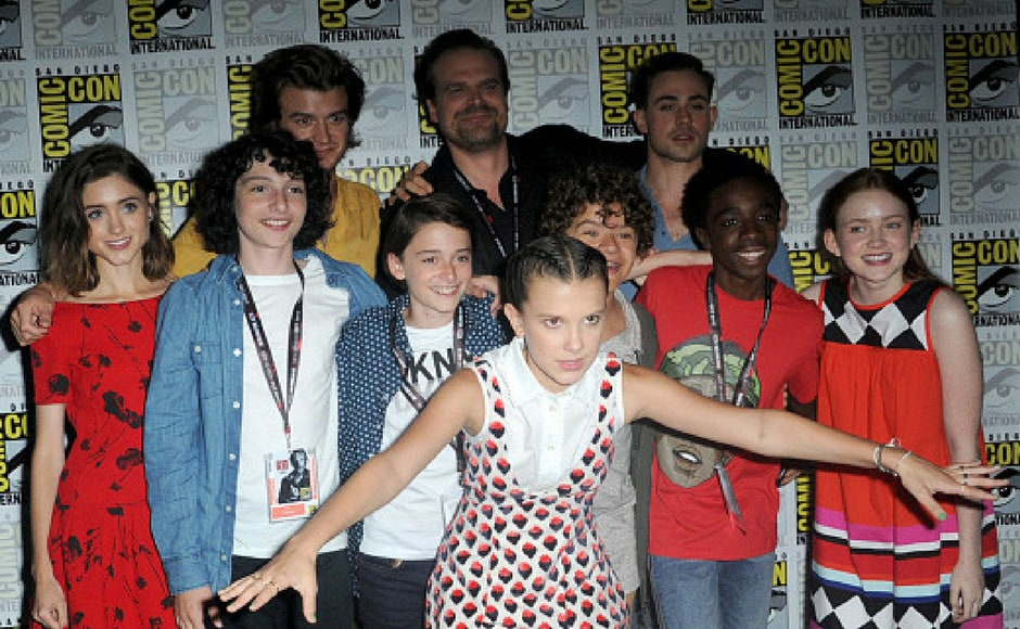 (L-R) Actors Natalia Dyer, Finn Wolfhard, Joe Keery, Noah Schnapp, David Harbour, Millie Bobby Brown, Gaten Matarazzo, Dacre Montgomery, Caleb McLaughlin, and Sadie Sink at Comic-Con International 2017 Netflix's Stranger Things panel in San Diego, California. (Getty Images)