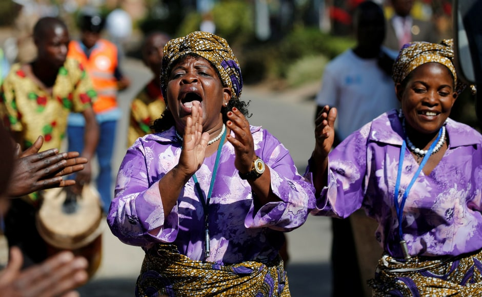 Women sing before the opening of the Mercy James hospital, a hospital named after one of Madonna's adopted child, Mercy James, in Blantyre, Malawi. (Reuters)