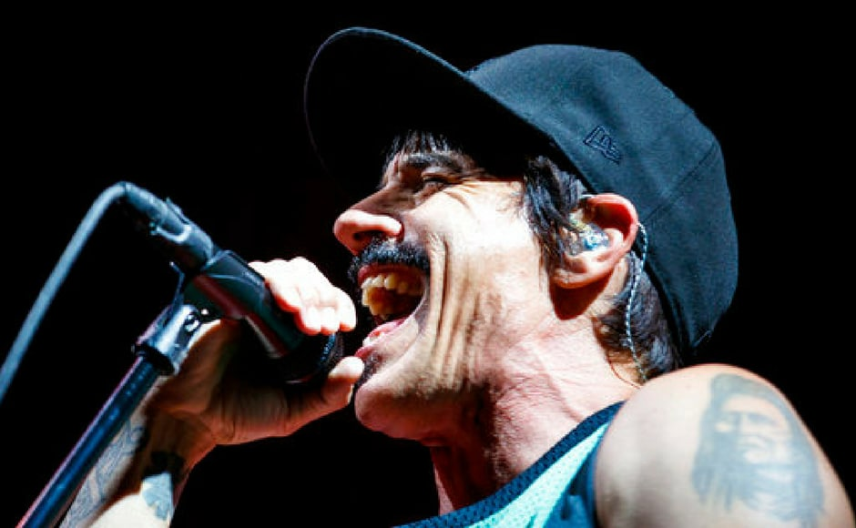 Red Hot Chili Peppers frontman Anthony Kiedis performs on stage during the first day of the 42nd Paleo Festival, in Nyon, Switzerland. The event runs from July 18 to 23. (AP Photo)