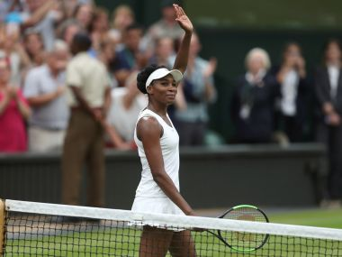 Venus Williams waves as she celebrates winning her match against Jelena Ostapenko. Reuters