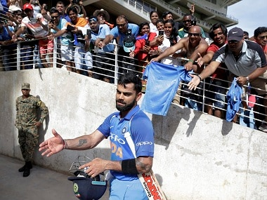 India's captain Virat Kohli leaves the field after his team defeated West Indies on Thursday. PTI