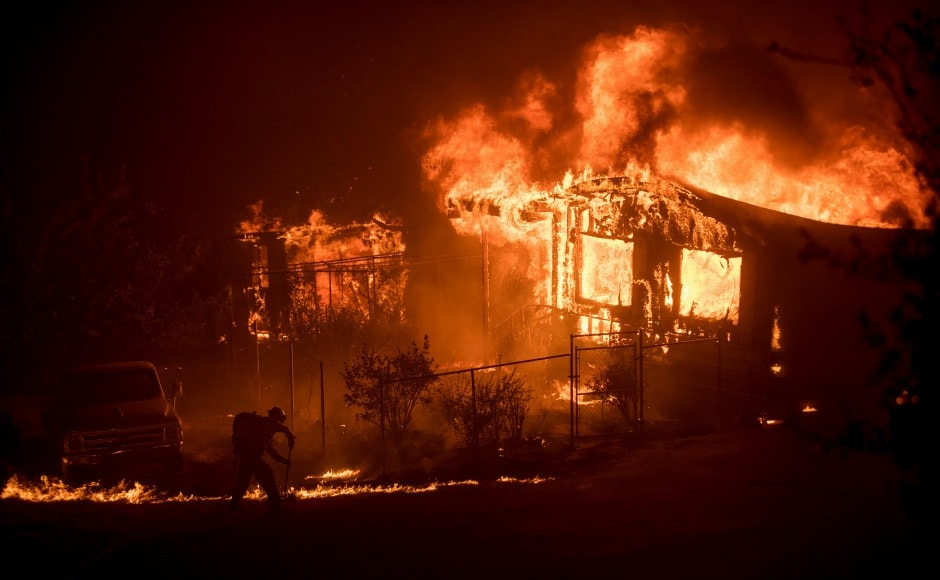 Wildfires across California's valleys on Sunday destroyed homes, propelling about 5,000 firefighters into action statewide. AP