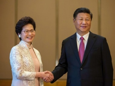 Xi Jinping, China's president, shakes hands with Carrie Lam on Friday. AP