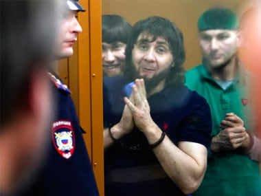 Zaur Dadayev (center left) listens to the sentence in a court room in Moscow, Russia, on Thursday. AP