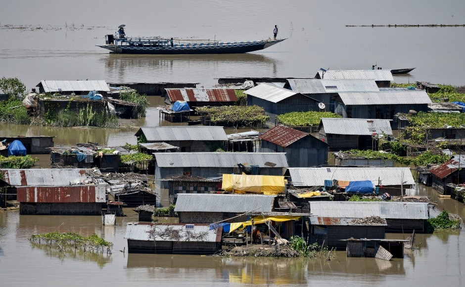 Villagers use a boat as they row past partially submerged houses at a flood-affected village in Morigaon. Due to impact of the flood, many roads, embankments and bridges have been damaged in several districts, including Lakhimpur, Biswanath, Goalpara, Bongaigaon, Dhubri, Golaghat, Majuli, Sivasagar and Karimganj. Reuters