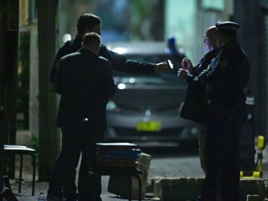 Australian Federal Police and NSW Police officers work in the Surry Hills suburb of Sydney, Australia on Saturday. AP