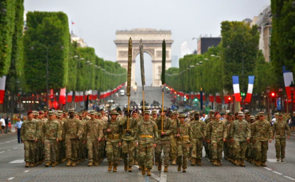 Members of US Army 1st Division, US Air Force, US Navy, and US Marines march down the Champs-Elysees Avenue during a rehearsal for the French Bastille Day parade in Paris. Bastille Day is the French National Holiday that commemorates the beginning of the French Revolution on 14 July, 1789. AP