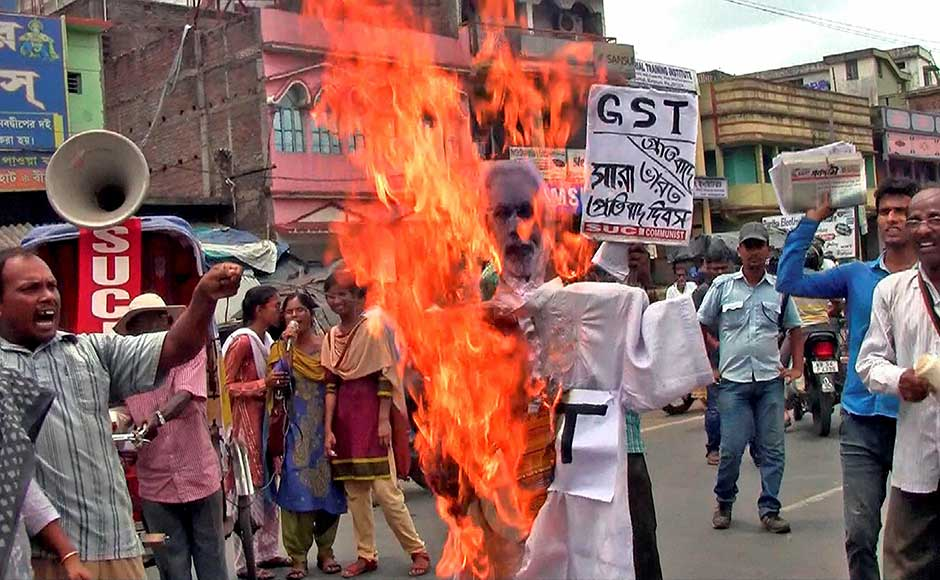 While there were celebrations across the nation, they were also interspersed with just as many protests. People burn an effigy during a protest against GST in Birbhum district of West Bengal. PTI