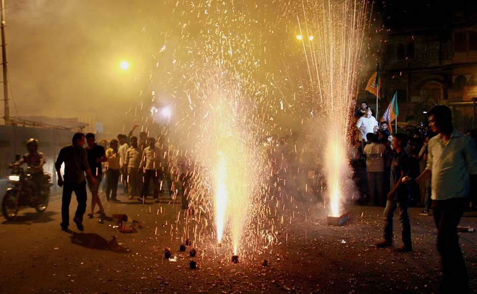 BJP members burst firecrackers to welcome GST in Jaipur. Under GST, the country's $2 trillion economy and 1.3 billion people will be unified into a common market. PTI