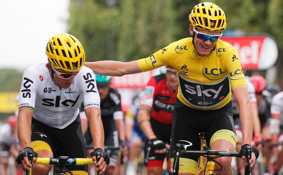 Tour de France winner Chris Froome(yellow jersey) and Poland's Michal Kwiatkowski cross the finish line of Stage 21 that marked the end of a three-week long gruelling race.  AP