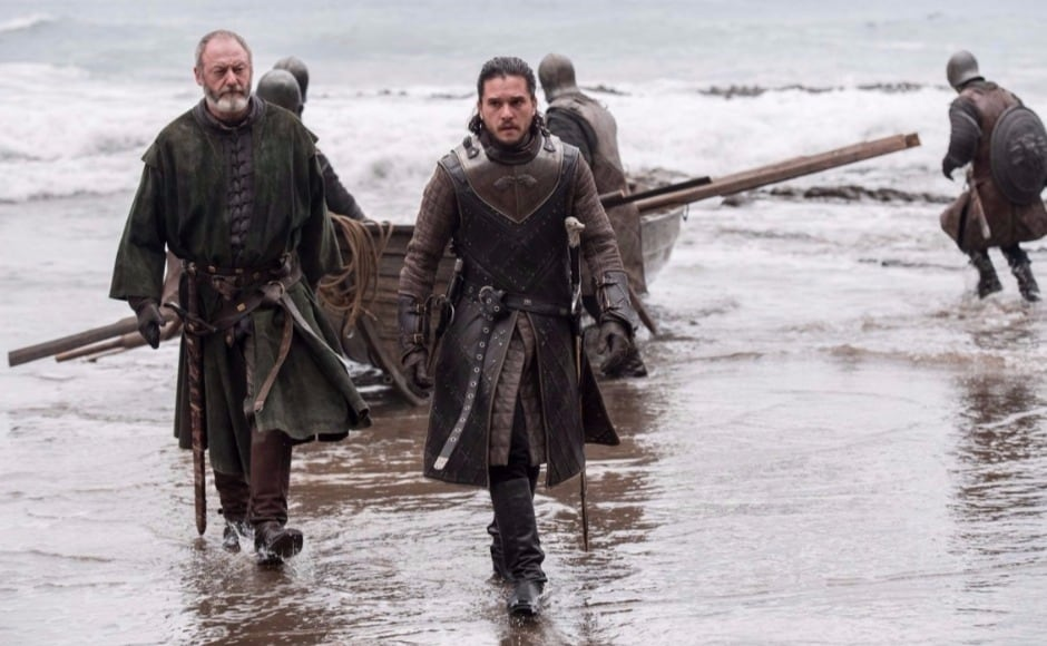 Episode two — 'Stormborn' — of Game of Thrones season 7 saw Jon Snow set off with Ser Davos for Dragonstone, to answer Daenerys Targaryen's summons, sent via Tyrion Lannister. Now, new photos released by HBO from episode 3 — 'The Queen's Justice' — see Davos and Jon reach the rocky shores of Dragonstone. Image via HBO