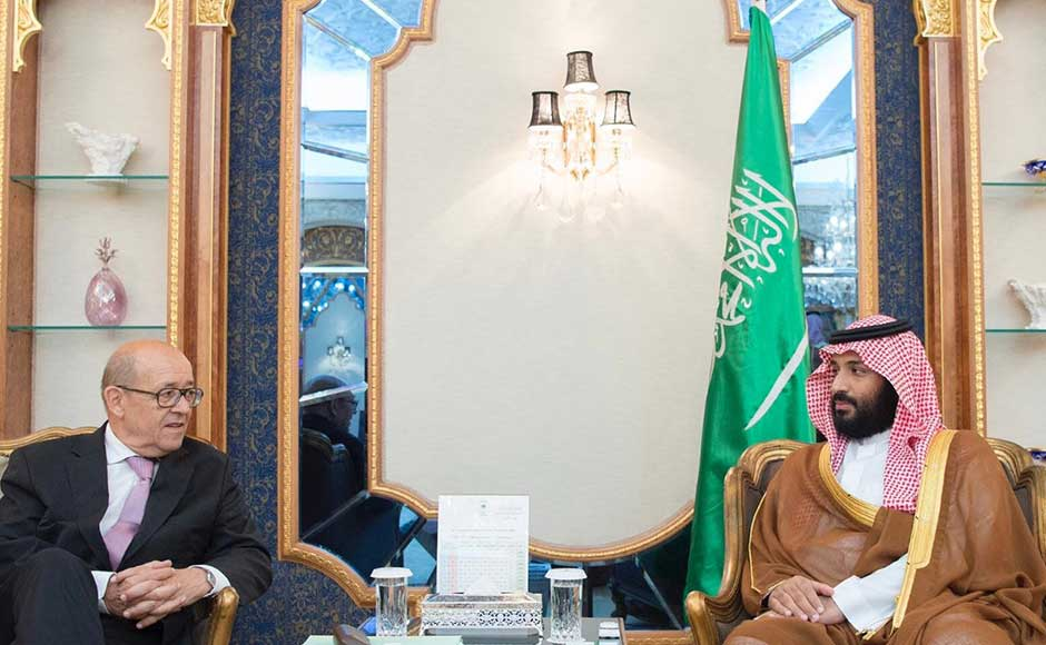 Riyadh and its allies imposed sanctions on Doha on 5 June, including closing its only land border, denying Qatar access to their airspace and ordering their citizens back from the emirate. They accused Doha of supporting extremism and being too close to their arch-rival Iran. In this image, Saudi Crown Prince Mohammed bin Salman, right, receives Le Drian in Jiddah, Saudi Arabia. AP