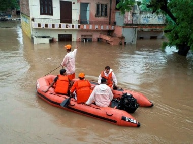 Rescue team at work in a flood-affected locality in Pali district of Rajasthan on Tuesday. PTI