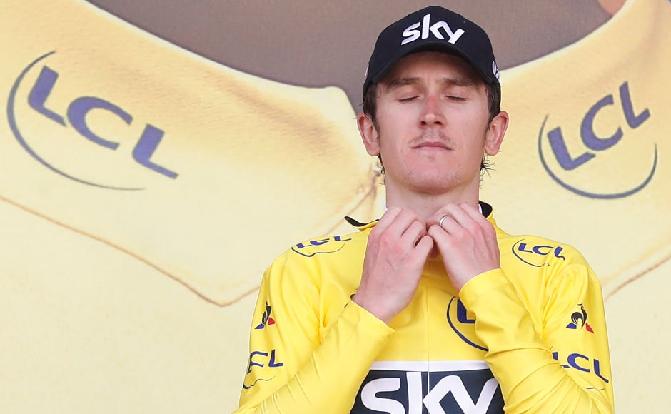 Tour de France Cycling - The 212.5-km Stage 3 race - Though he came 8th, Team Sky rider Geraint Thomas of Britain retained the yellow jersey (overall lead) on the podium. REUTERS