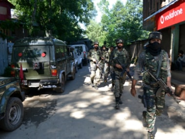 Soldiers near an encounter site in Dialgam village were two militants and two civilians were killed on Saturday. Firstpost/Sameer Yasir