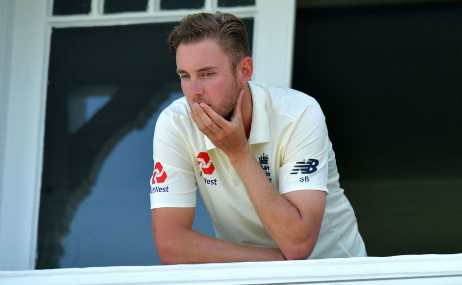 England's Stuart Broad looks out dejectedly from the dressing room balcony as South Africa claim victory on the fourth day of the second Test between England and South Africa at Trent Bridge. AFP