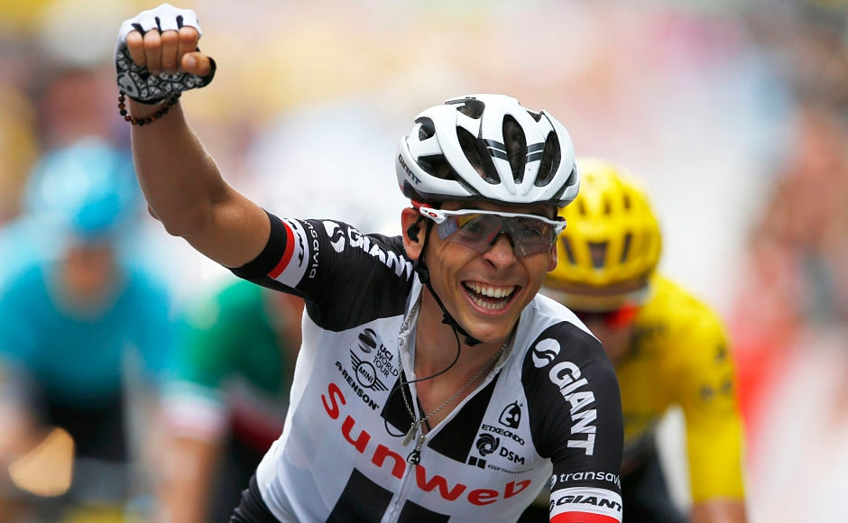 France's Warren Barguil celebrated prematurely as he crossed the finish line, thinking he won the sprint but Colombia's Rigoberto Uran finished ahead of him in a photo-finish to win the ninth stage of the Tour de France cycling race. AP