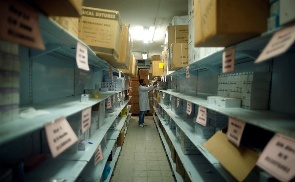 An employee checks medicines at a medicine warehouse run by health ministry, in Gaza City. In what is seen as the latest step in an effort to force Hamas to relinquish its control of Gaza, Abbas in June reduced the payments the PA makes to Israel for electricity it supplies to the territory. Reuters