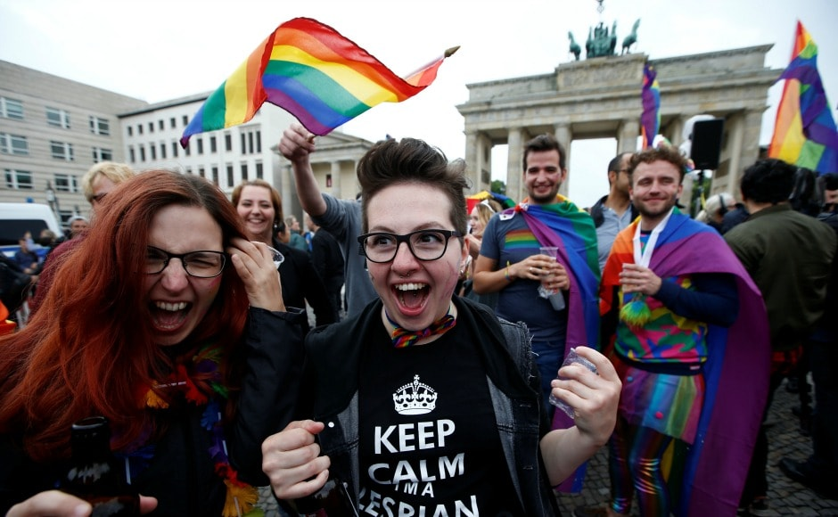After the decision was passed, hundreds of LGBT rights activists celebrated outside the Bundestag after the vote. The activists are seen waving rainbow flags and placards that read