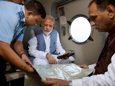 Narendra Modi had conducted a survey of Gujarat floods last week. PTI