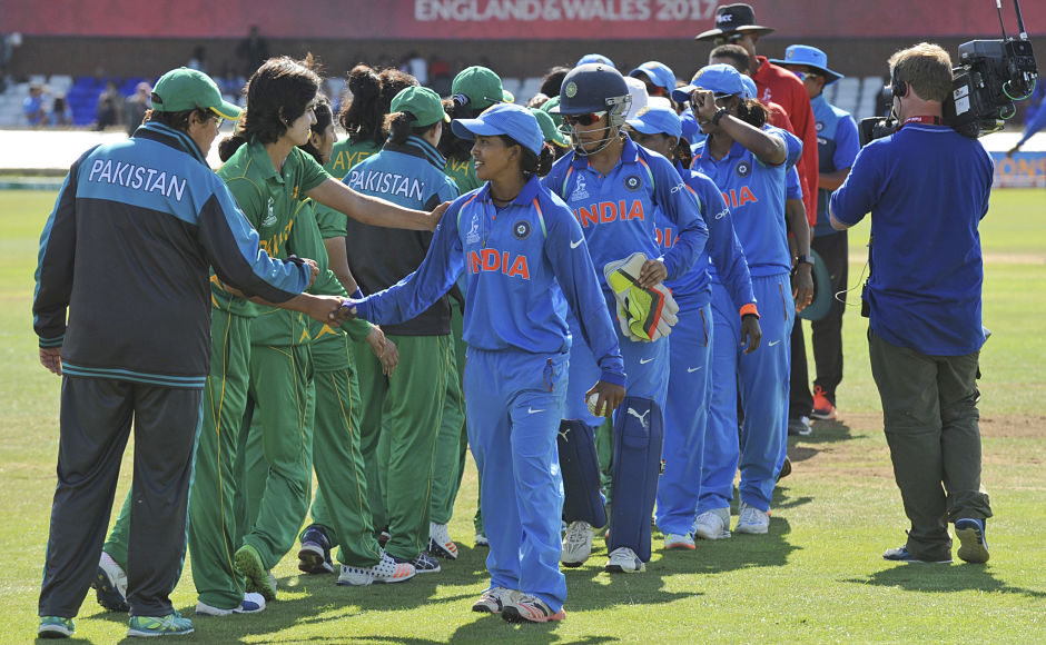 Indian, in blue, and Pakistani cricketers shake hands at the end of the ICC Women's World Cup 2017 match between the two teams that saw India beat Pakistan by 95 runs. AP