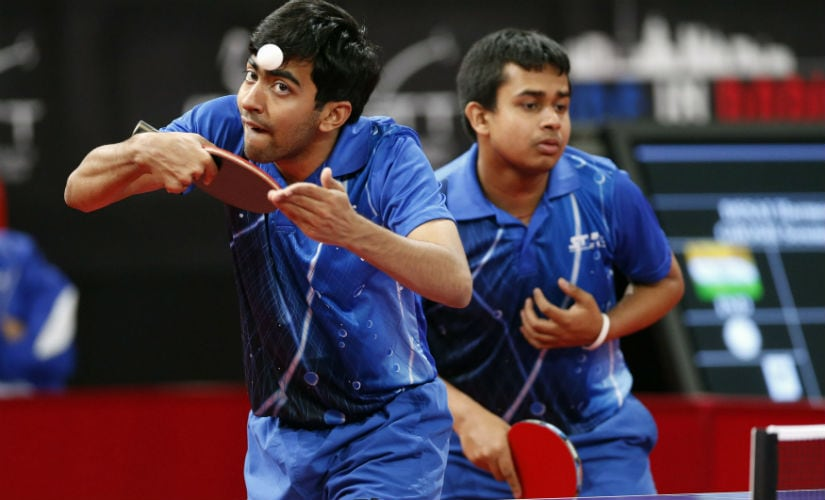 Harmeet Desai (L) and Soumyajit Ghosh (R) serve to Taiwan's Wu Chih-chi and Lee Chia-Sheng during their men's double qualifying rounds at the World Team Table Tennis Championships in Paris May 14, 2013. Reuters
