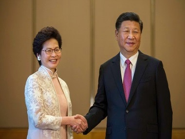 Xi Jinping with Carrie Lam. AP