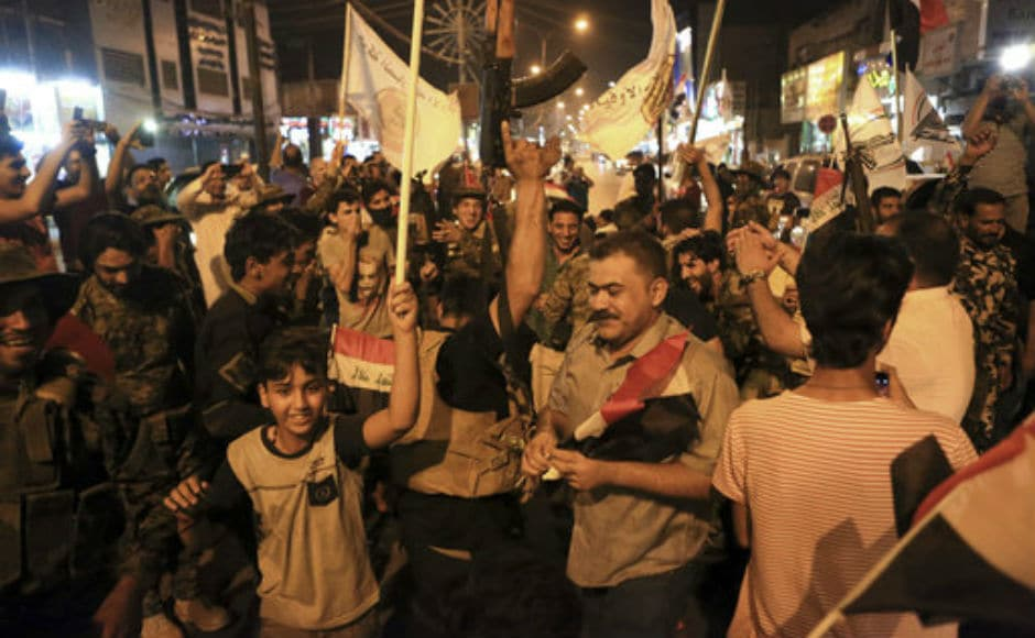 People took to the streets across major cities of Iraq like Baghdad and Basra after government forces secured victory against the Islamic State. AP
