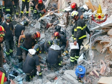 Firefighters search amid rubble of a collapsed apartment in Torre Annunziata, near Naples, Italy. AP