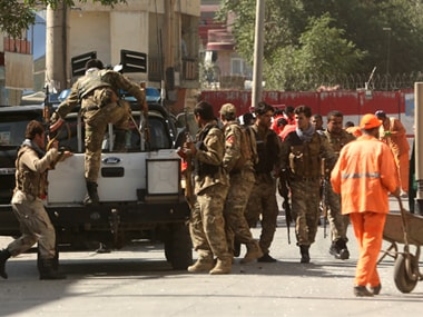Security forces leave the site of a suicide attack in Kabul on Tuesday. AP