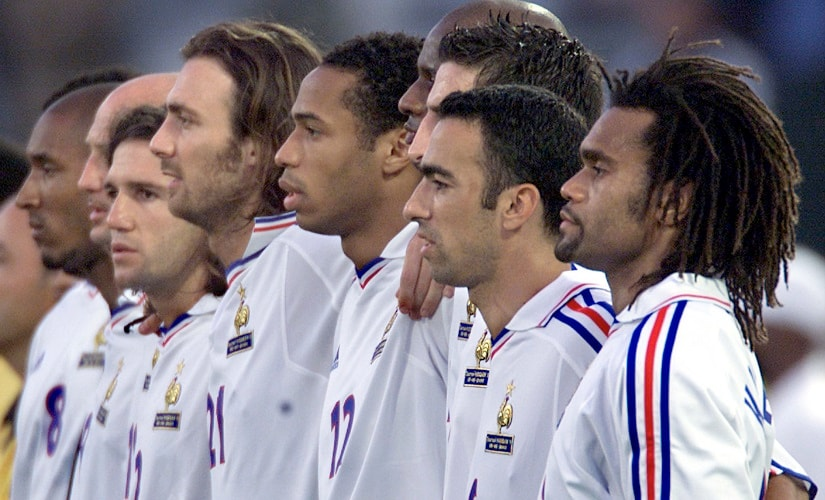French national soccer team members listen to their national anthem before facing Morocco in the King Hassan II tournament in Casablanca June 6. The World champion squad arrived today in Belgium to prepare the upcoming Euro 2000 championship. France's opening match in the Euro 2000 is against Denmark next Sunday in Bruges. L to R:Nicolas Anelka, Franck Leboeuf, Vincent Candela, Christophe Dugarry, Thierry Henry, Youri Djorkaeff and Christian Karembeu. CP//ME - RTRV5Z4