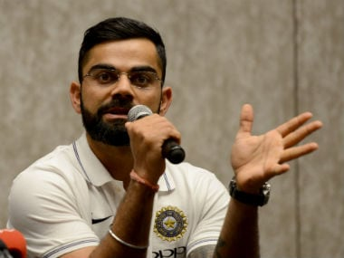 Indian captain Virat Kohli in conversation with the media before the team's departure for Sri Lanka, in Mumbai on 19 July. AFP