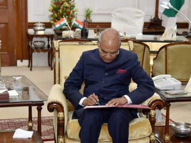 President Ram Nath Kovind signing in a register at Rashtrapati Bhavan on his arrival from parliament house after the swearing-in ceremony. PTI