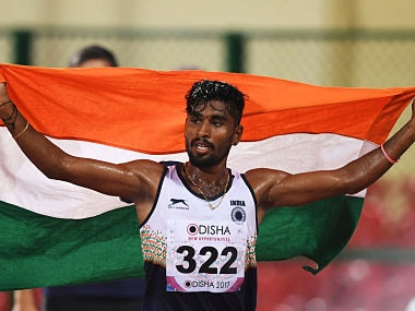 Indian athlete G Lakshmanan celebrates after winning the Gold medal in the men's 5000m runs during the first day of the 22nd Asian Athletics Championships. AFP
