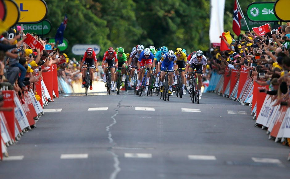 Peter Sagan of Slovakia, far right, leads the sprint of the pack to to win the third stage of the Tour de France cycling race. AP