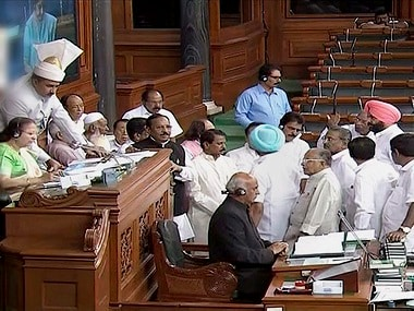 Members protest in the well of the Lok Sabha. PTI