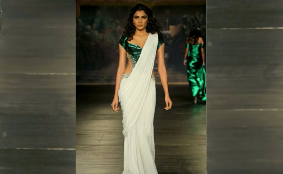 There were lehengas, evening dresses, cocktail saris, evening gowns, crop tops and ball skirts. Image from<em> News 18</em>.