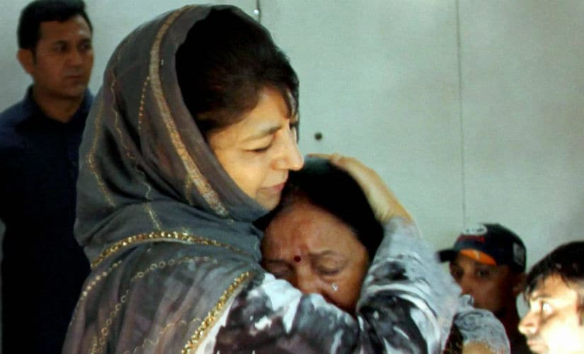 Jammu and Kashmir chief minister Mehbooba Mufti consoles an Amarnath pilgrim who survived the Anantnag militant attack, before she was airlifted to New Delhi, at the airport in Srinagar on Tuesday. PTI