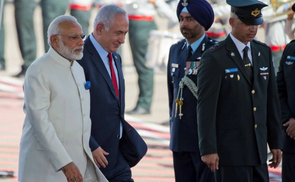 Narendra Modi (L) and Israeli primeminister Benjamin Netanyahu being escorted by Israeli officials to the stage during the welcome ceremony. AP