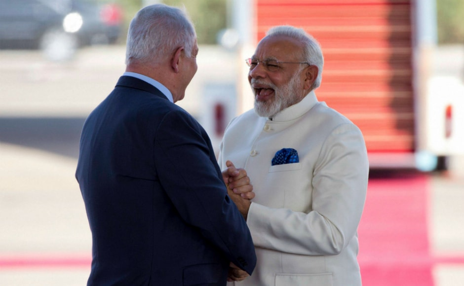 Prime Minister Narendra Modi, right, and Israeli primeminister Benjamin Netanyahu shake hands at the Ben Gurion Airport. AP